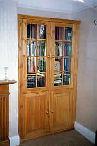 glass fronted pine bookcases